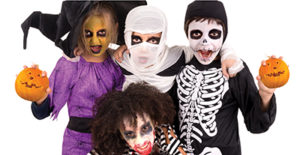 four kids dressed in halloween costumes