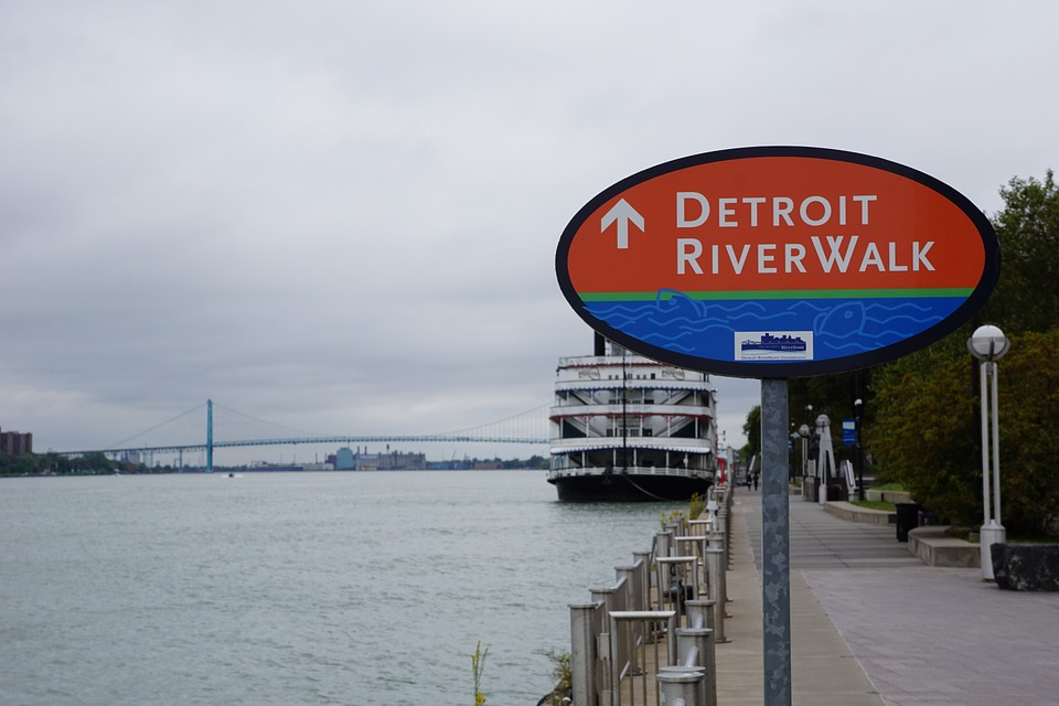 A sign pointing to the Detroit Riverwalk