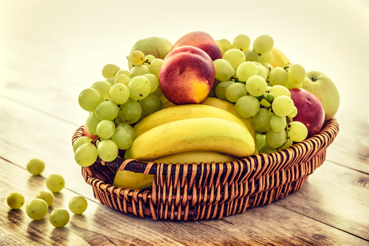 Basket of Fruit with grapes, bananas and apples