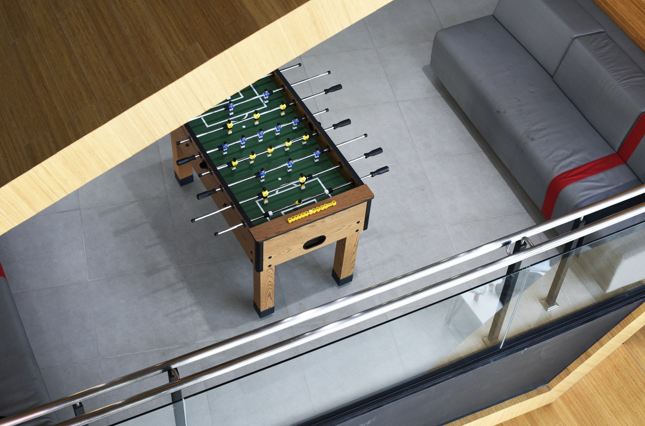 Looking down from above at a foosball table