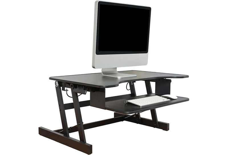 black sit-stand desk with Imac computer