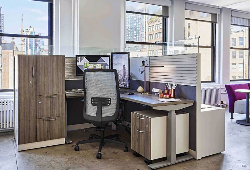 modern city cubicle with filing cabinets, desk and chair