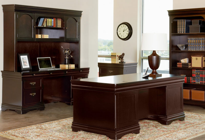 large office with classic wooden shelving, bookcase and desk