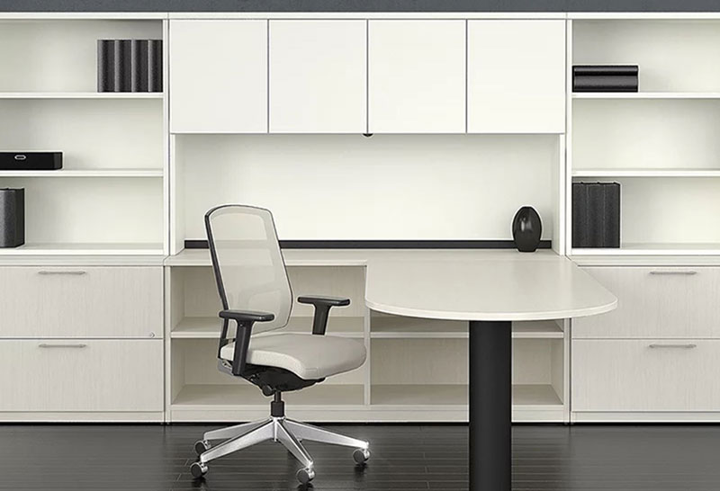 white L-shaped desk, white chair and large white shelves and drawers