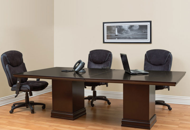 stone and wooden conference table, three chairs, phone and laptop