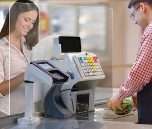 woman at cashier behind clear screen