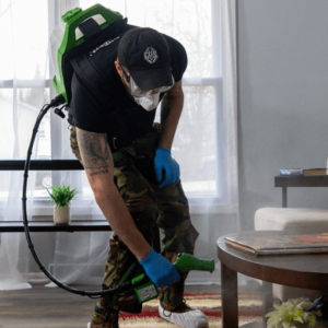 man with microbial sprayer