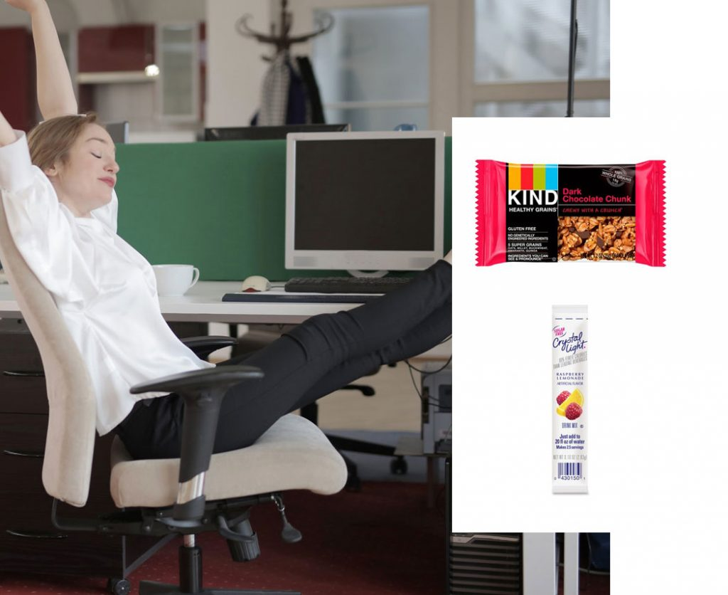Woman at her desk stretching